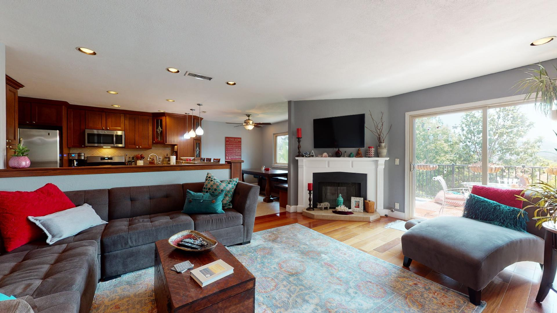 6577 Camino Capistrano living room with fireplace